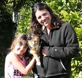 Rhonda with here daughter and a cat