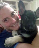Suzie with a black dog